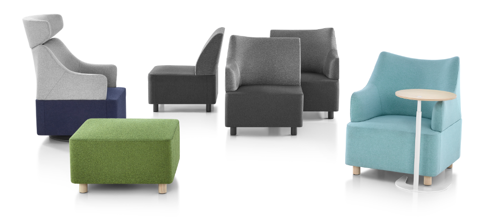 green upholstered ottoman, gray and blue armchair, gray modular seating, aqua armchair with small circular wood and white desk in a white room