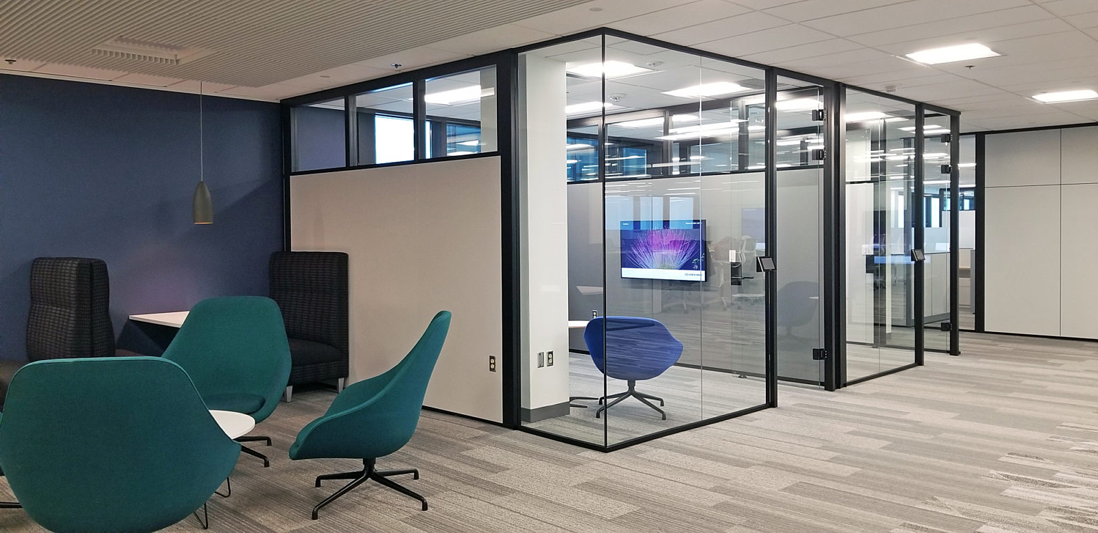 Office space with glass rooms and sitting area