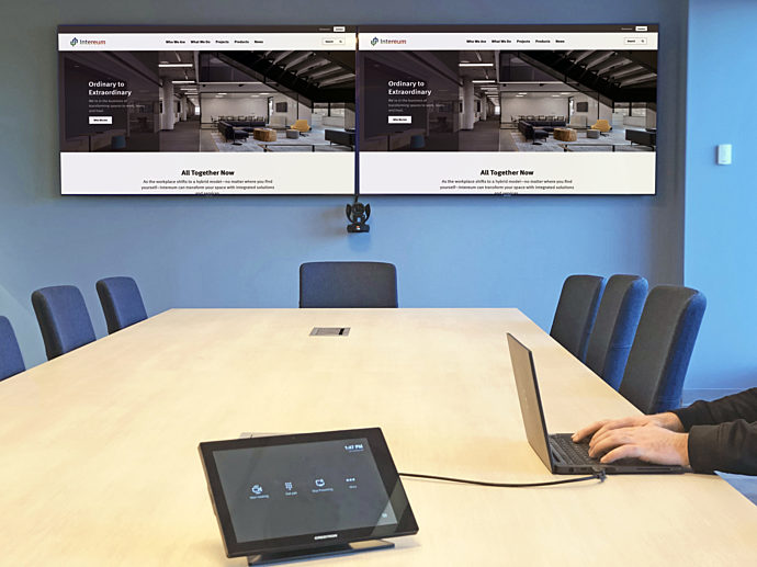 Two TV screens in a conference room
