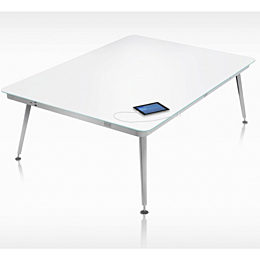 white top square table with four silver chrome tube legs and tablet plugged in, in white stark room